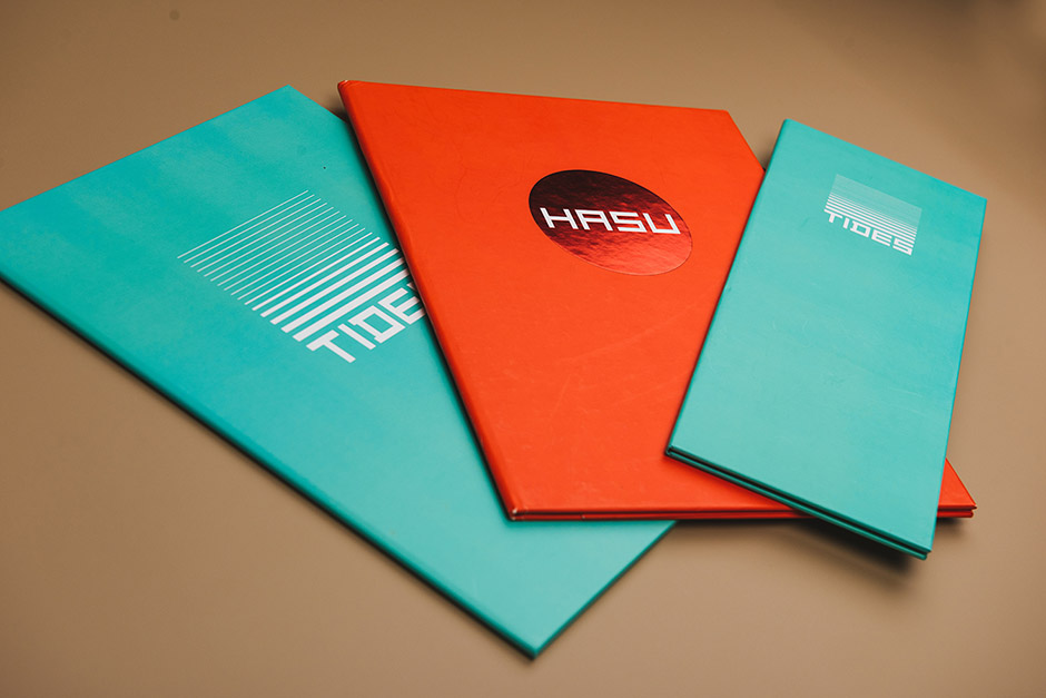 Tides and Hasu menu-holder, Sun Resorts, printed by Précigraph